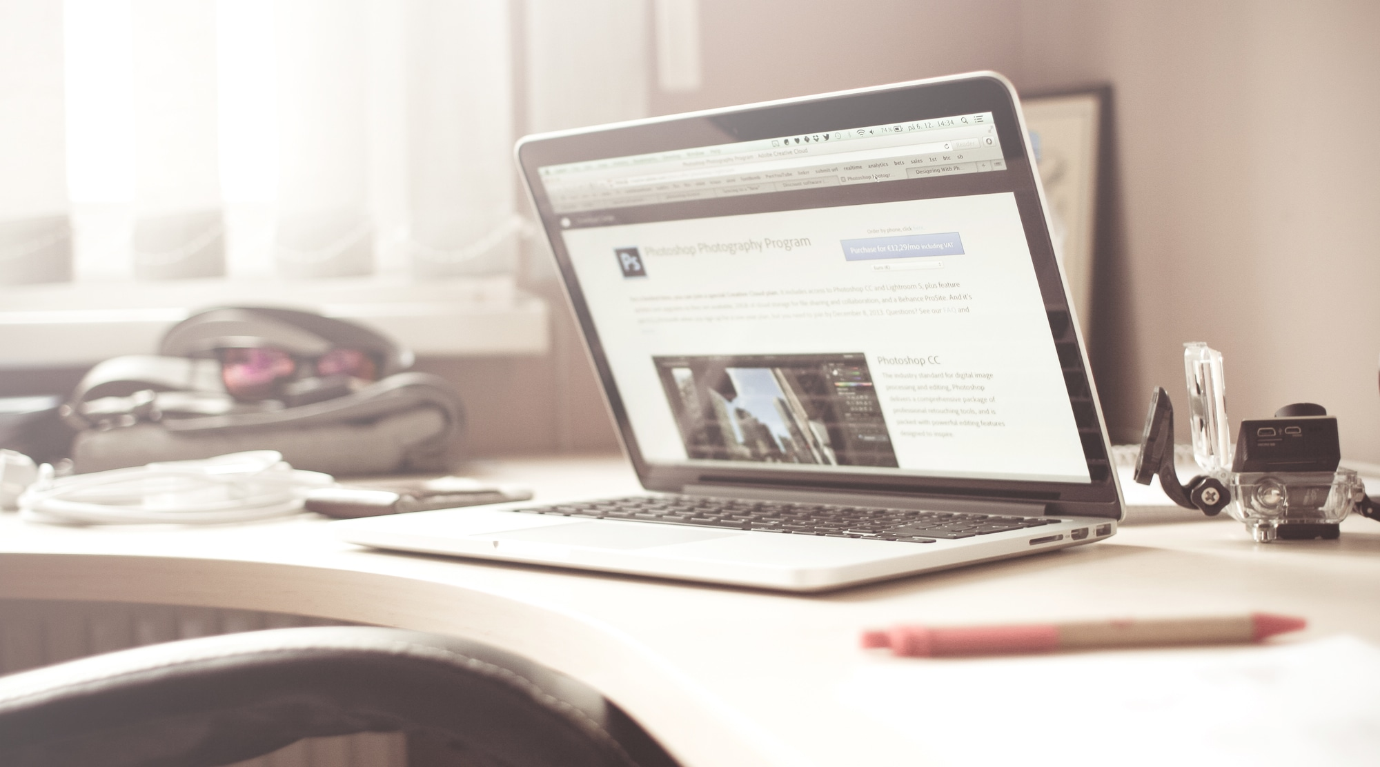 laptop on work desk digital platforms website design software - Desk Design Software